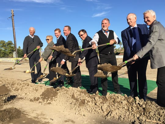 From left, Palm Springs City Council members Chris Mills, Ginny Foat, former Councilman Rick Hutcheson, former Mayor Steve Pougnet, Mayor Robert Moon, City Councilman J.R. Roberts, developer Lawrence Rael and  City Councilman Geoff Kors break ground on the Hyatt Andaz hotel.