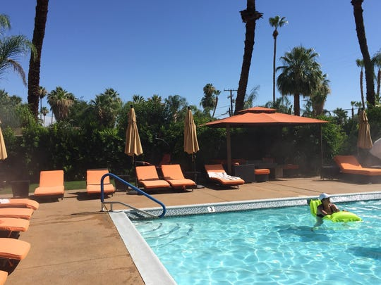 Visitors relax at the pool at the Little Paradise Hotel in Palm Springs. The hotel is in the top 25 small hotels in the United States, by TripAdvisor.