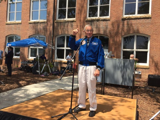 Former Astronaut Charles Duke speaks outside the State