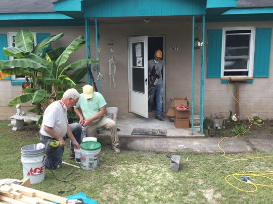Upstate volunteers with the Baptist disaster relief service work on repairs to a woman's home in Nichols damaged by flooding from Hurricane Matthew.