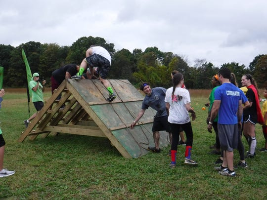Nearly 400 participants enjoyed 10 obstacle-stations over a nearly three-quarter mile field course.