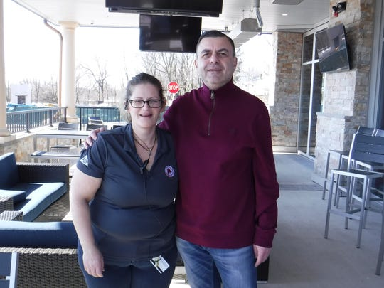 Arooga's Grille House & Sports Bar of East Brunswick independent franchisee Igor Zak with General Manager Liz Bryant. With the launch of Arooga's, Zak now owns two businesses on Route 18 in East Brunswick. He also owns a Dunkin' Donuts/Baskin-Robbins.