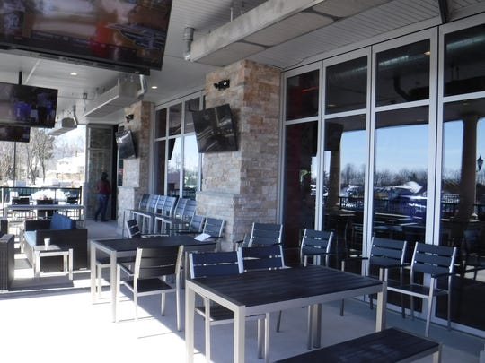 "The spacious patio at Arooga's in East Brunswick. The glass doors open fully to allow access to the bar and provide a television ""viewing experience even outside,"" according to Gary Huether, president/founder of Arooga's."