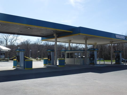 An extensive Valero fuel station featuring a modern canopy sits in front of the convenience store.