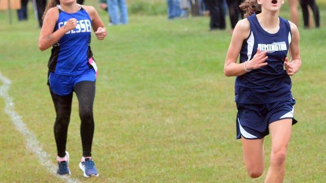 Remington runner Audrey Van Zelfden, right, was a Class 2A state qualifier last season.