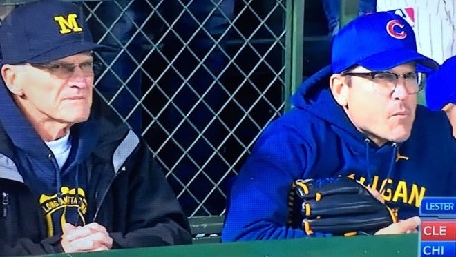 Jack Harbaugh, left, and Jim Harbaugh watch Game 5 of the World Series at Wrigley Field Sunday.