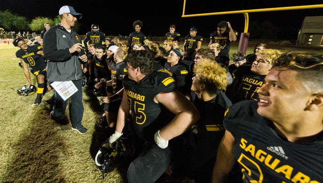 Saguaro head coach Jason Mohns gives a quick congratulation speech to his players after they won the Division 4A semifinal playoffs on Friday, Nov. 18, 2016, at Desert Mountain High School in Scottsdale.