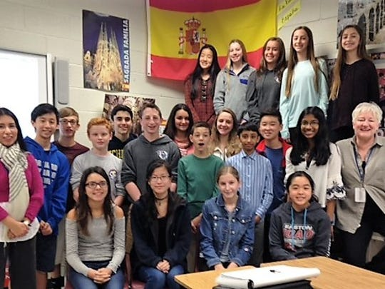 Twenty-one 8th graders earned honors on the 2017 National Spanish Examinations. Pictured here with their teachers, Angela Della Ventura (R) and Paola Gower (L) are some of the winners.