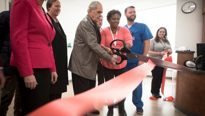 Frank Dixon, Francis J. Dixon Foundation, and Wellspan Physician Ericka Powell ceremoniously cuts the ribbon that opens new behavioral health care units at Good Samaritan emergency room.