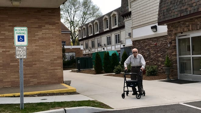 Nick Langella illustrates how close St. Anthony's parking is to his front door at Franklin Street Villa in Northvale.