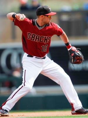 Arizona Diamondbacks' Chris Owings  throws to first base against the Colorado Rockies during a spring training game on Tuesday, March 29, 2016, at Salt River Fields at Talking Stick near Scottsdale.