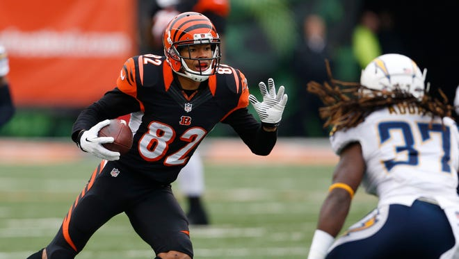 Bengals wide receiver Marvin Jones makes a move against San Diego Chargers defensive back Jahleel Addae during the first quarter of their game at Paul Brown Stadium in January of 2014.