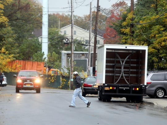 A pedestrian crosses Commerce St. in Spring Valley Oct, 24, 2017 near the spot that a woman was struck and killed last week in a hit and run incident.