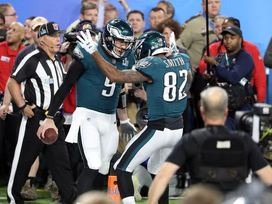Philadelphia Eagles quarterback Nick Foles (9) celebrates with wide receiver Torrey Smith (82) after scoring a touchdown during the second quarter in Super Bowl LII against the New England Patriots at U.S. Bank Stadium.