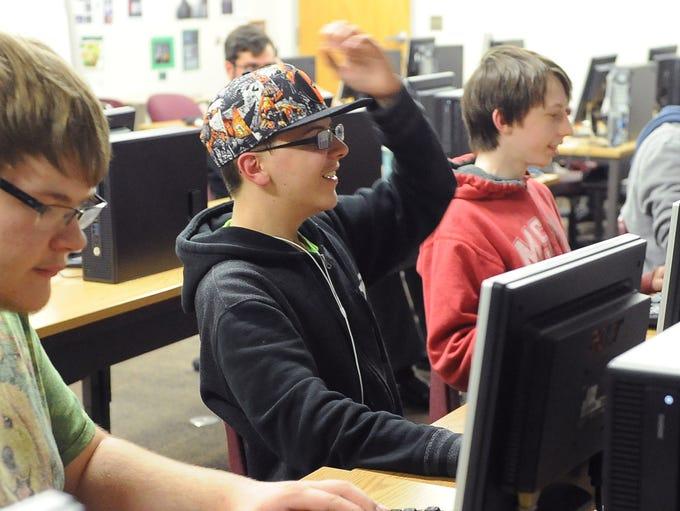 High School freshman Chris Manne (center) reacts during
