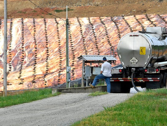A tanker truck driver fills his tanker with waster water from a leachate collector system at the Decatur County landfill in April 2017.