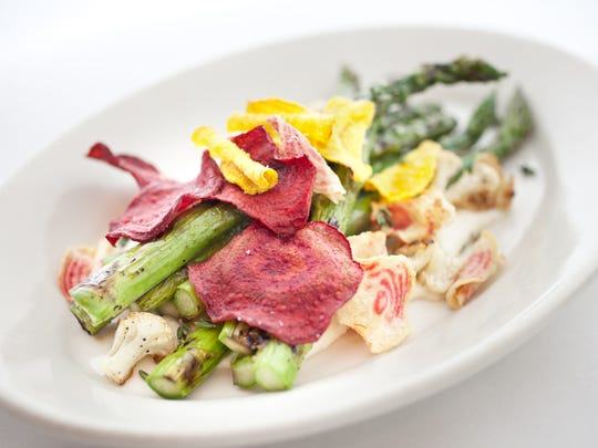 A dish of asparagus and beet chips made by chef Charleen Badman at FnB in Scottsdale, AZ on Friday, January 7, 2011.