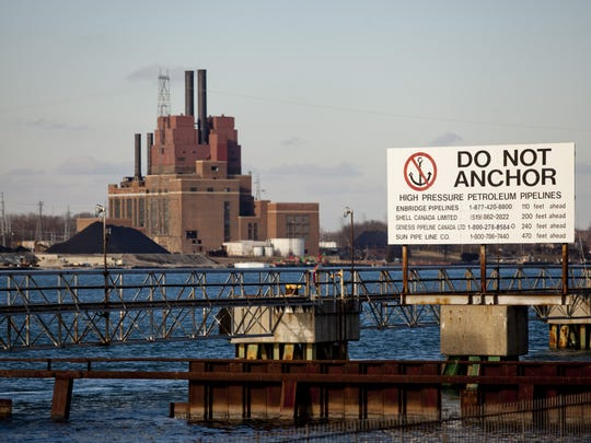 A sign warns boaters of pipelines under the St. Clair