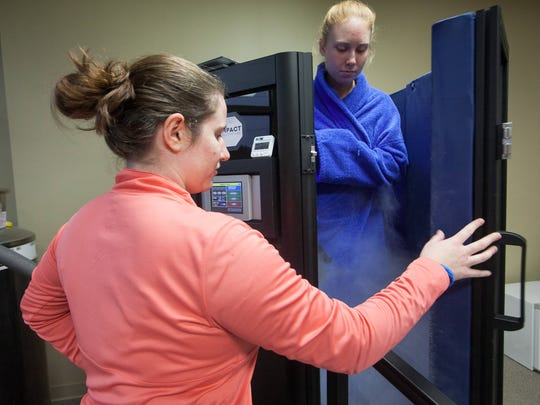 Tara Carr, 18, a senior at Conrad School of Science exits the cryotherapy chamber after her three minute session at First State Health and Wellness.