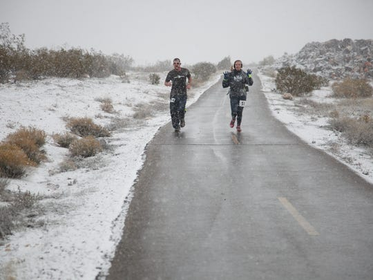 Runners compete in the Expedition St. George, a 50 mile team really race that winds from the Town Square Park in downtown St. George, up through Snow Canyon State Park, through Washington Fields and back around the Southern Parkway to the Dixie Center Saturday, Dec. 7, 2013. Despite the cold and wintery conditions, 42 teams, most comprised of five team members, competed in the relay race.