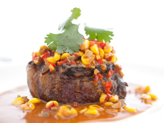 Bright corn kernels and finely diced peppers garnish a charred filet of beef from ZuZu in Scottsdale.
