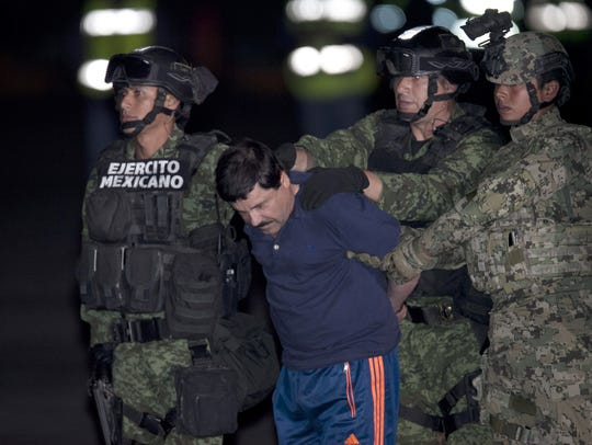 "Joaquin ""El Chapo"" Guzman is escorted to a helicopter"