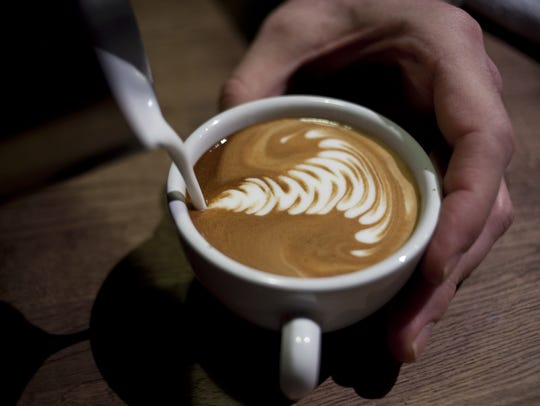 David Cook makes a cappuccino at Cartel Coffee Lab in Tempe.