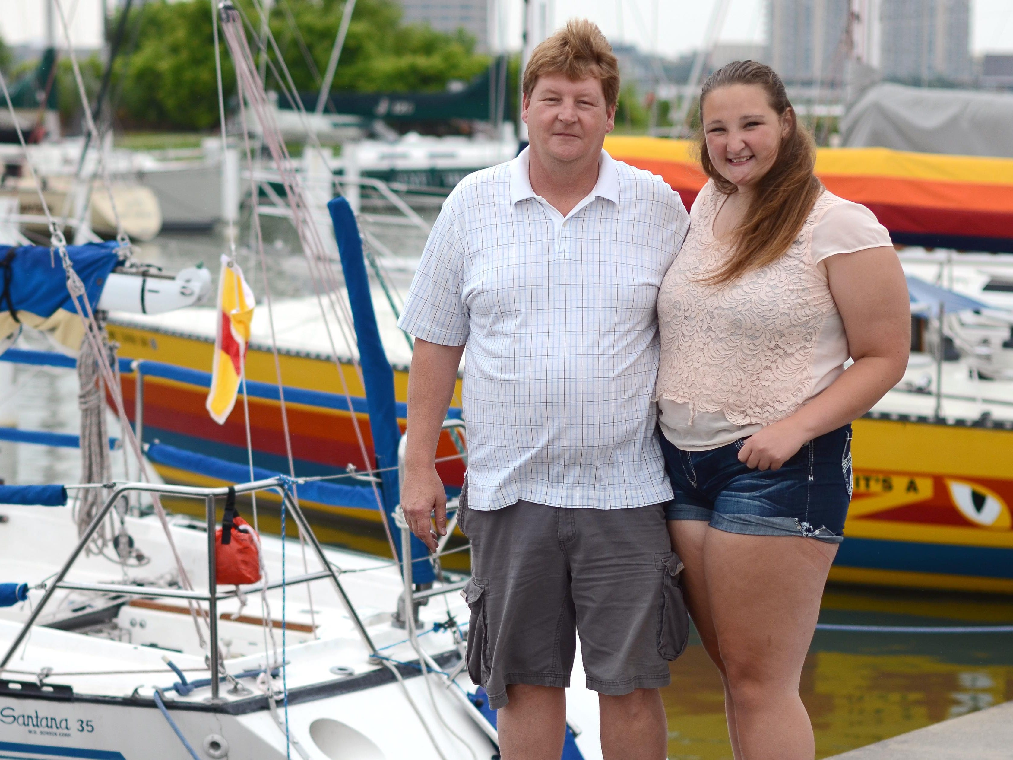 Dave Knupp and his daughter Olivia, 15, Monday, July 13, at the Port Huron Yacht Club. Olivia will be racing in her first Mackinac Race this year.