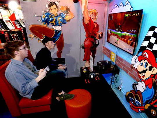 Schyler Pierce, left, and Dillon Holt play Mario Kart on Tuesday, March 28, 2017, at the downtown Murfreesboro Barcadium.