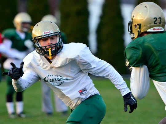 Joe Bauhof covers a receiver during pass defense practice