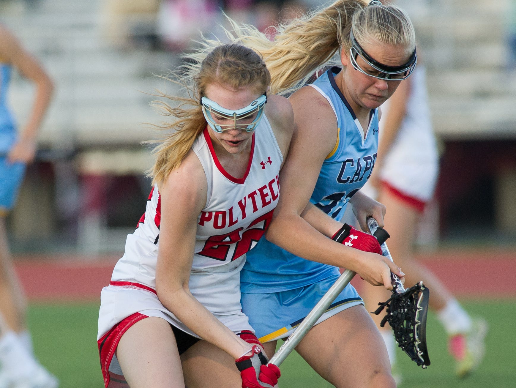 Polytech's Alison McKay (22), left and Cape Henlopen's Evelyn Shoop (22) battle for the ball during the second half of play.