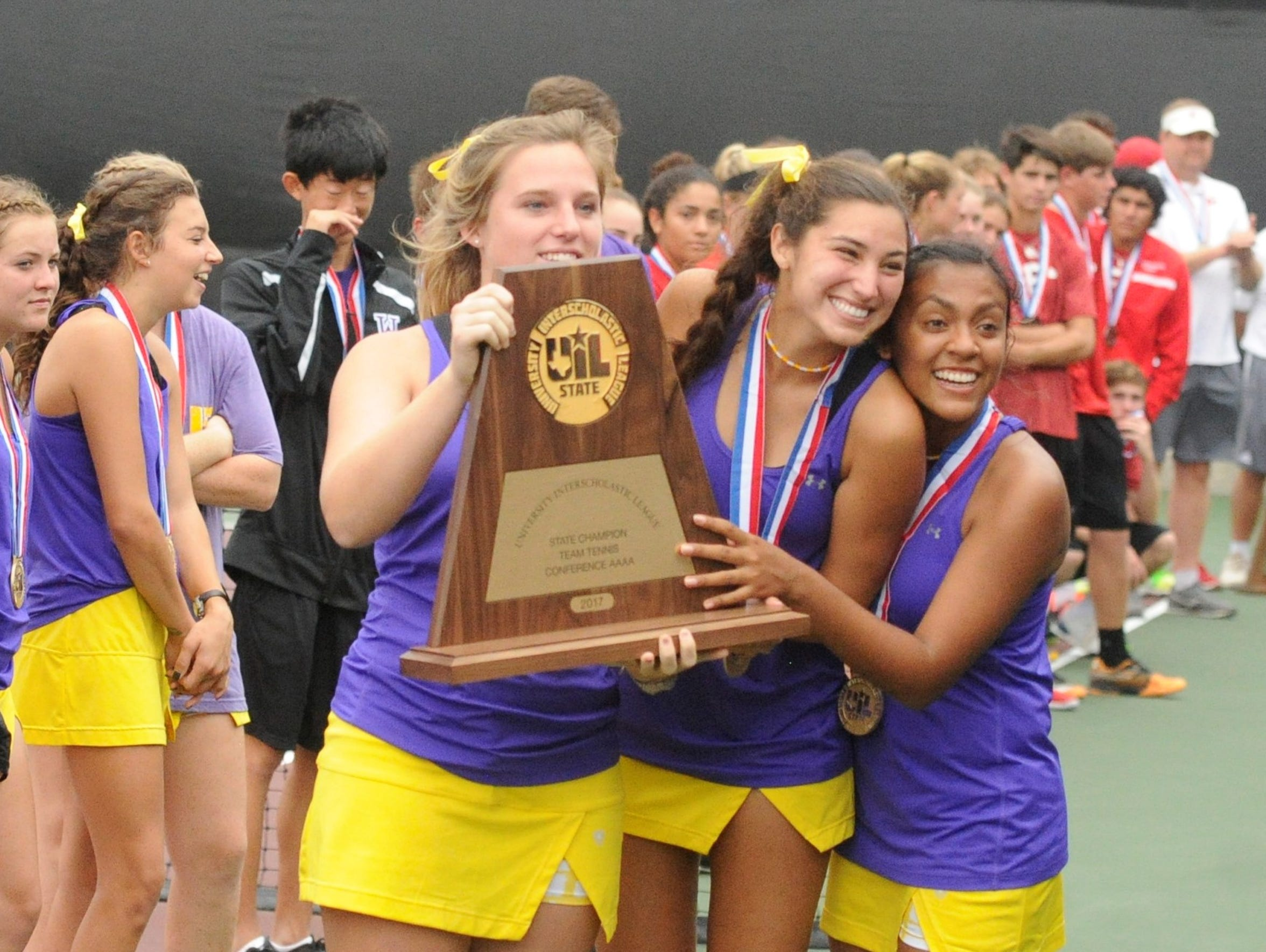 Wylie senior girls Andrea McMillan, Kaitlyn Hathorn and Shruti Patel pose with the Class 4A state championship trophy after a 10-0 win against Fredericksburg.
