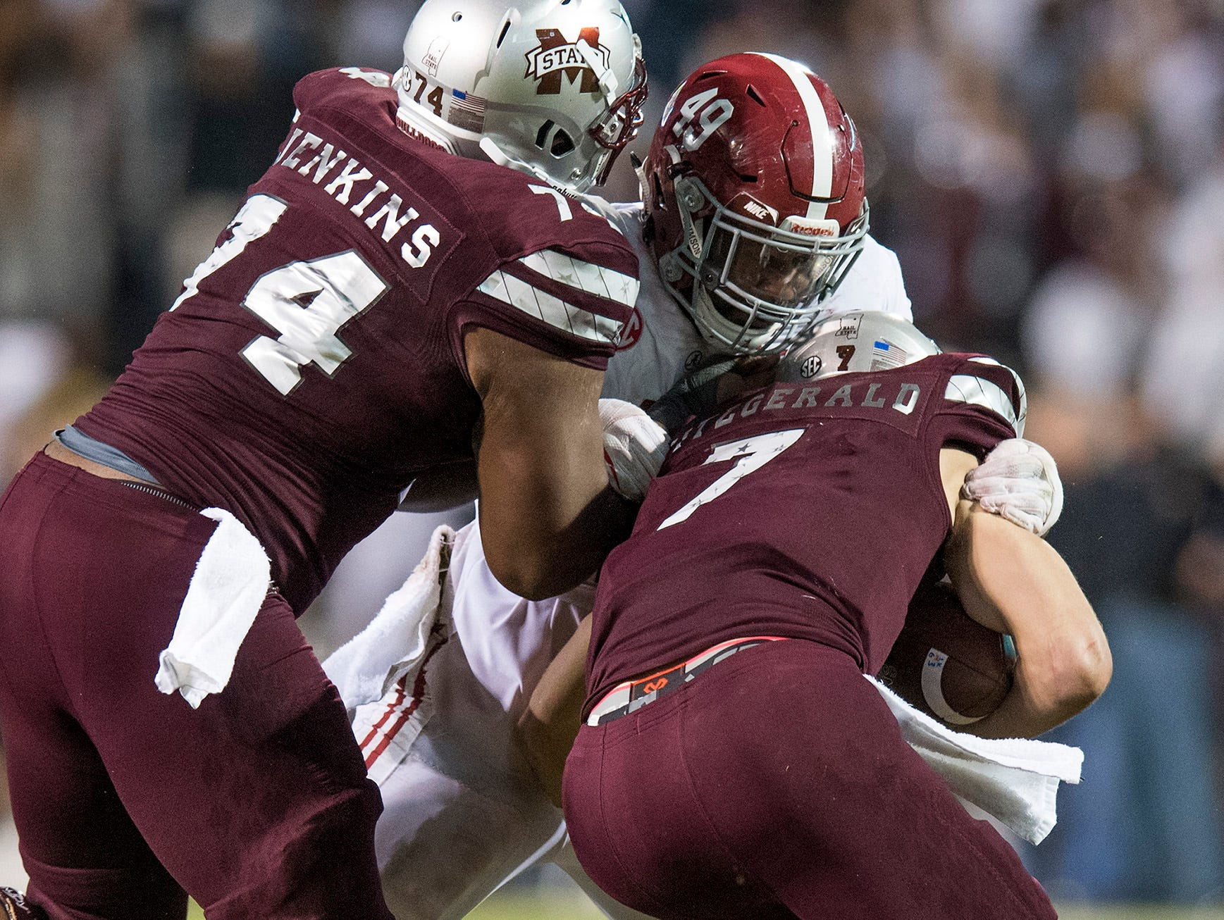 Alabama defensive lineman Isaiah Buggs (49) stops Mississippi State quarterback Nick Fitzgerald (7) late in second half action in Starkville, Ms. on Saturday November 11, 2017. (Mickey Welsh / Montgomery Advertiser)
