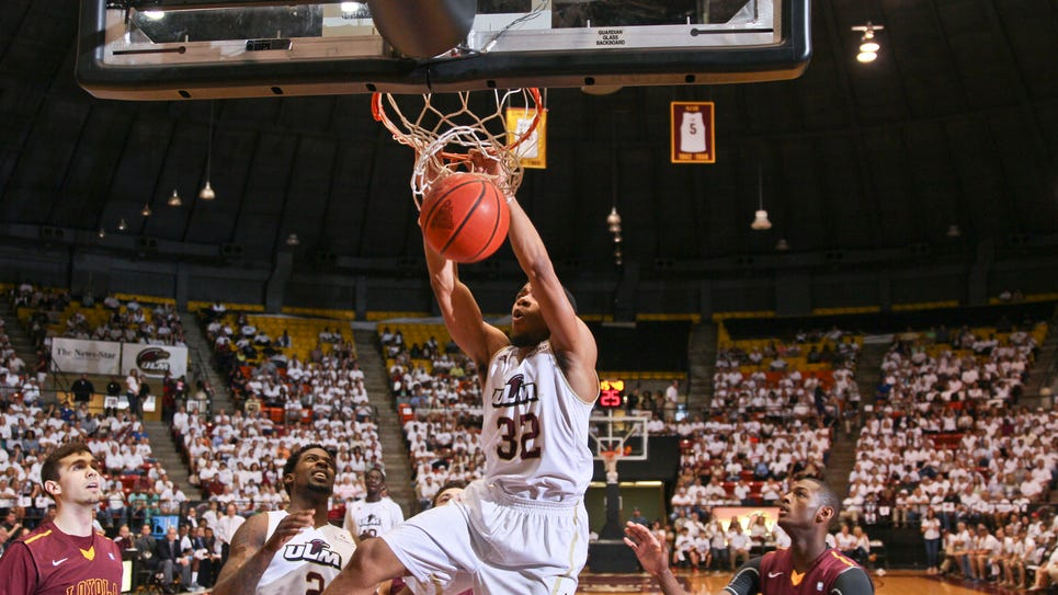 ULM's Justin Roberson dunks against the Loyola-Chicago