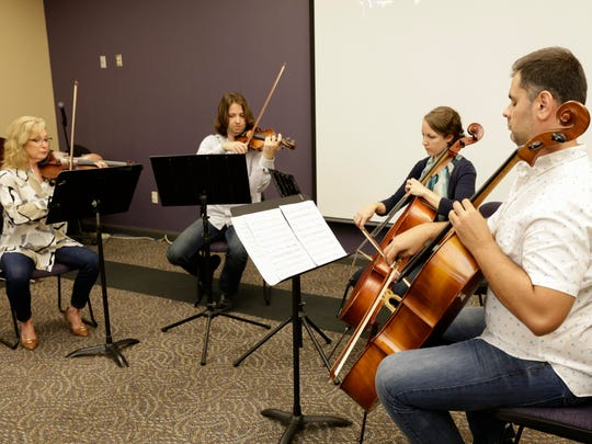 Members of the Acadiana Symphony Orchestra perform
