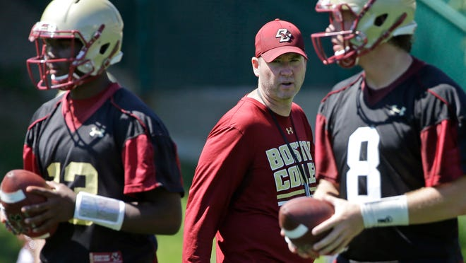 Boston College offensive coordinator Scot Loeffler speaks to his players during football practice, Monday, Aug. 8, 2016, in Boston. (AP Photo/Elise Amendola)
