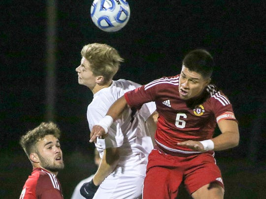 Bridgewater's Dom Demcak (left) and Kearny's Cristian Villegas go up for a header in the Group IV boys soccer semifinal on Nov. 1, 2017 in Franklin.