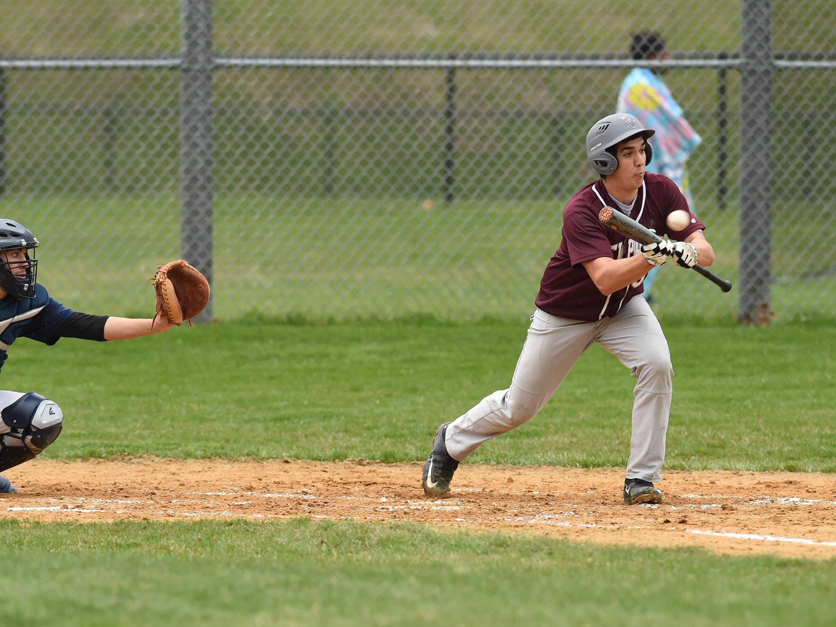 New Paltz's Tyler Black hits a bunt during Monday's game against Highland.