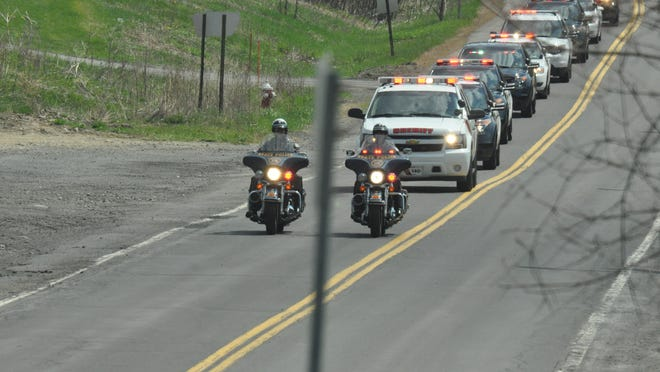 A motorcade of vehicles traveled from North Gate Plaza to the Broome County Sheriff's Office in 2015.