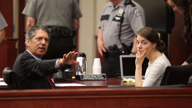 Shayna Hubers (right) charged with murder in the shooting death of her boyfriend, Ryan Poston, talks with her attorney, David Mejia before jury selection for her trial in Campbell Circuit Court Monday.