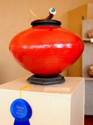 Rudy Lucero drew the top prize with his finished work of a Raku Pot with pedestal.
