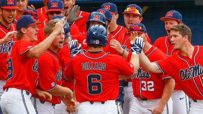 Ole Miss' Thomas Dillard (6) celebrates with teammates after hittinga two-run home run during the fourth inning of a Southeastern Conference tournament NCAA college baseball game against Auburn, Friday, May 25, 2018, in Hoover, Ala. (AP Photo/Butch Dill)