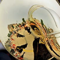 The Kiel Municipal Band is reflected in the bell of a Sousaphone during the  Independence Day Parade Saturday July 4, 2015 in Sheboygan.