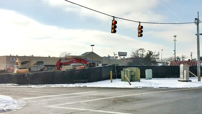 Demolition is underway at the former Blockbuster Video store for a fuel station in front of the Kroger store in Monfort Heights at 3491 North Bend Road.