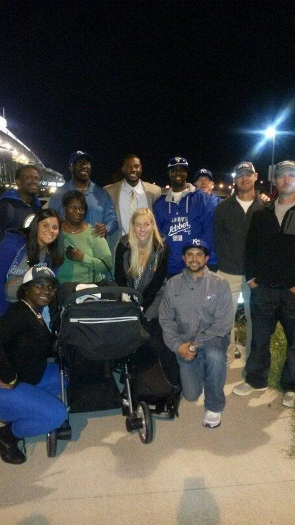 Lorenzo Cain (back row, center) is surrounded by family
