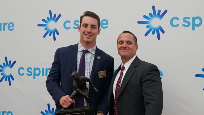 Mississippi State first baseman Brent Rooker and coach Andy Cannizaro pose for a picture with the C Spire Ferriss Trophy that Rooker won Monday at the Mississippi Sports Hall of Fame and Museum.