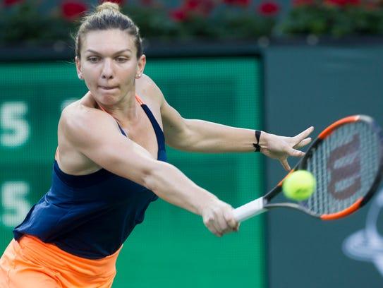 Simona Halep of Romania beats Croatian  Donna Vekic