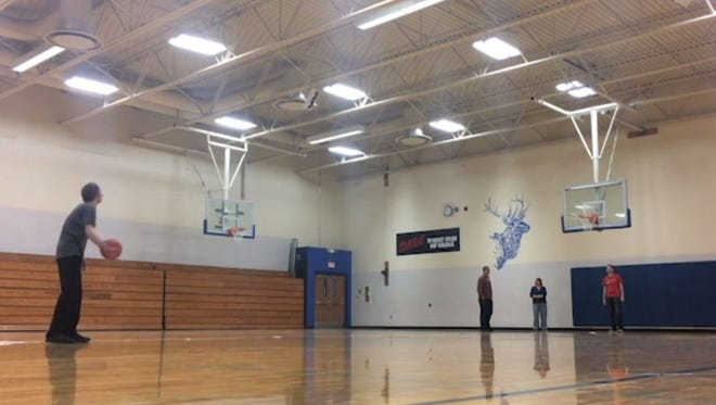 Jason Boll attempts what he says is a world-record breaking behind the back shot from halfcourt in Elkton.