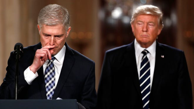 Judge Neil Gorsuch pauses as he speaks in the East Room of the White House in Washington, on Tuesday, Jan. 31, 2017, after President Donald Trump announced Gorsuch as his nominee for the Supreme Court.