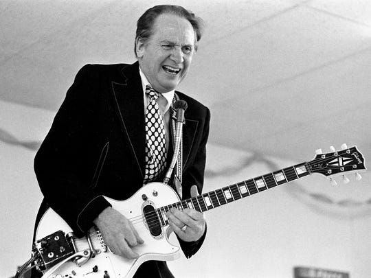 Les Paul and his legendary guitar are performing at